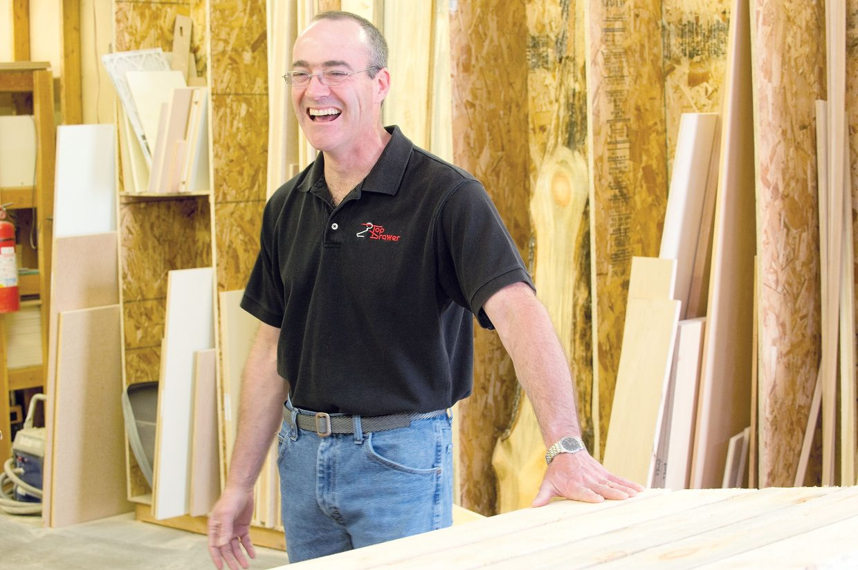 Chris Bradley, of Sacred Resource, laughs while talking about the beetle-killed wood he uses to make compost bins. Bradley is using beetle-killed lumber to build the environmentally friendly bins.