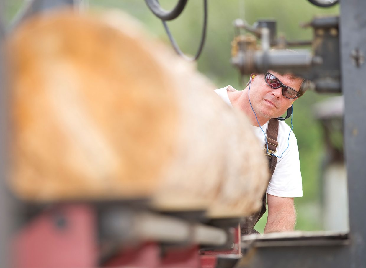 Ed Watson, of Wood Wise Productions, runs beetle-killed lumber through his sawmill near Milner.