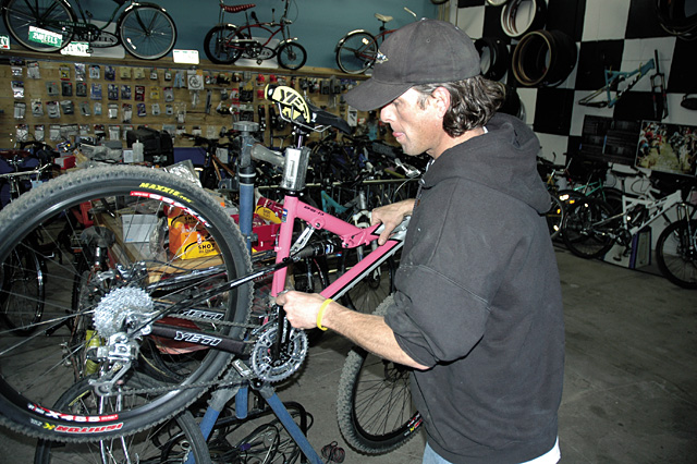 Wheels Bike Shop owner Chris Johns takes a look at the carbon fiber rear suspension triangle on a new '07 Yeti ASR SL cross-country race bike.
