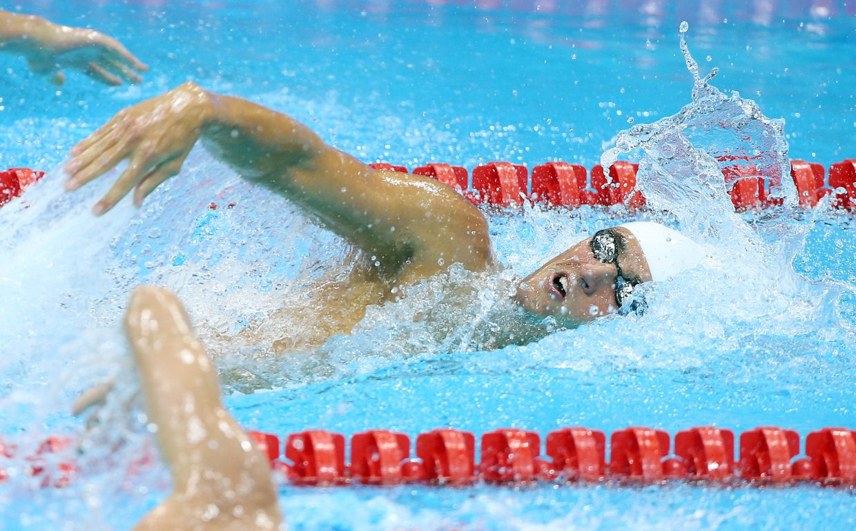 Steamboat Springs swimmer Blake Worsley competes in the 800-meter freestyle relay Tuesday. Worsley was competing for Team Canada, which finished 14th.