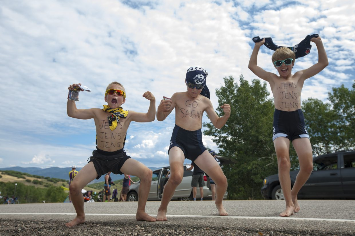 Boys showing their excitement for the Pro Challenge riders at the top of Apple Flats. Boy on left is Bennett Gamber, age 12. Submitted by: Beth Provo-Hanlen