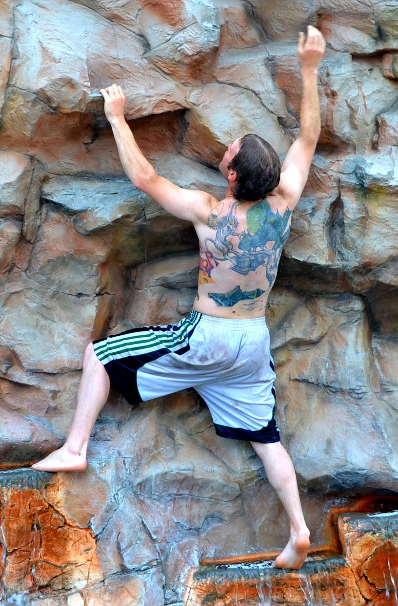 Brant Wolfgram easily climbed the climbing wall at the Old Town Hot Springs this morning, and showed off his intricate back tattoo. Submitted by: Shannon Lukens