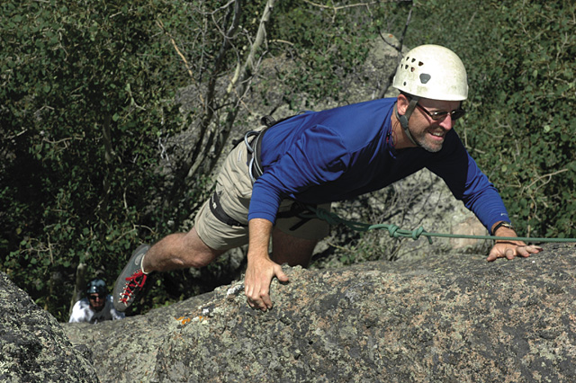 Ohio resident Mike Malley climbs up one of the top-rope routes overlooking Harrison Creek Canyon on July 4, on belay from Rocky Mountain Ventures guide Patrick Meyer, bottom left.