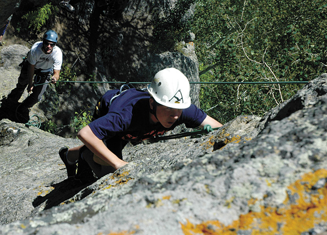 Rocky Mountain Ventures guide Patrick Meyer, left, belays Bill Malley on a July 4 climb up the granite crags overlooking Harrison Creek Canyon.