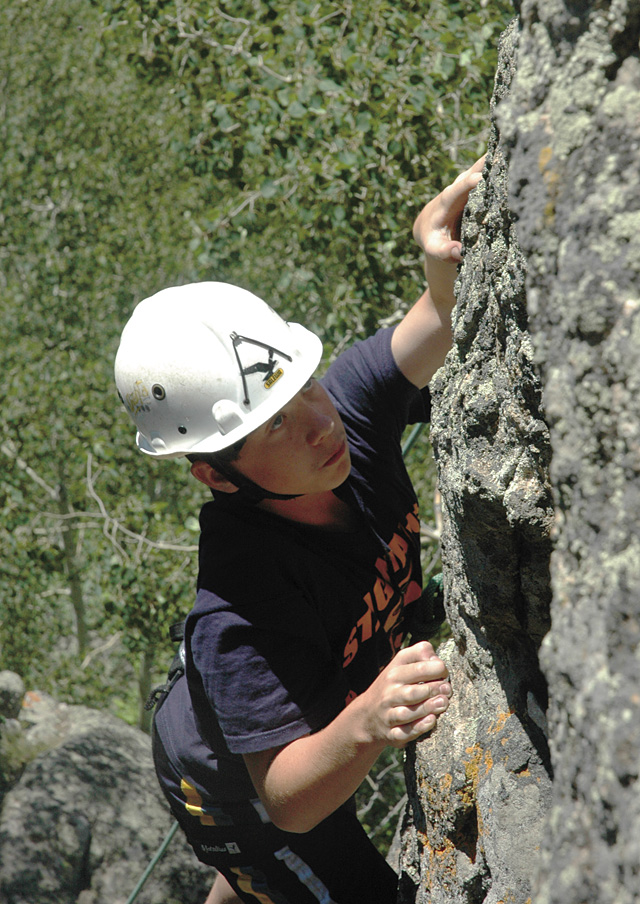 Bill Malley climbs up the granite crags overlooking Harrison Creek Canyon on July 4.