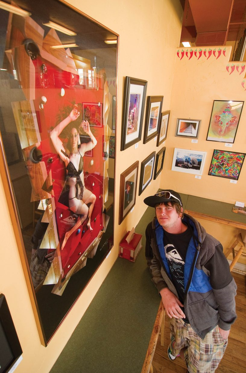 Photographer Mark Brubaker Jr. stands by his photograph that is hanging in the Azteca Taqueria in downtown Steamboat Springs. The work is a collage made up of hundreds of individual photographs.