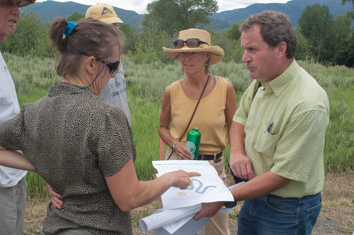 Resident Sarah Katherman talks with Randy Sackett, of Civil Design Consultants, which is engineering the road, during a walk through of proposed changes to the Colorado Mountain College campus in Steamboat Springs. Katherman was interested in a proposed road, which will provide secondary access to the campus.