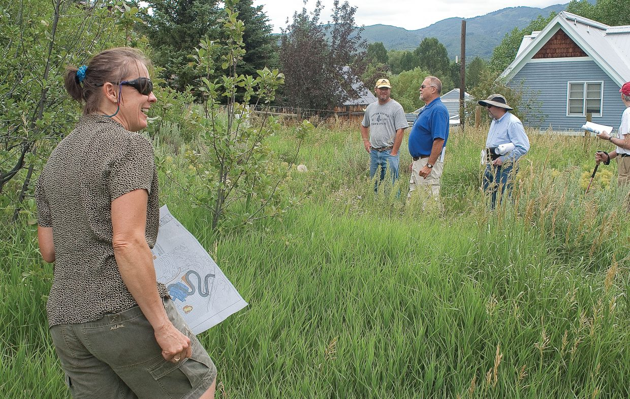 Sarah Katherman, a resident near a proposed road for Colorado Mountain College Alpine Campus, talks about the impacts the road might have on her home, located in the background.