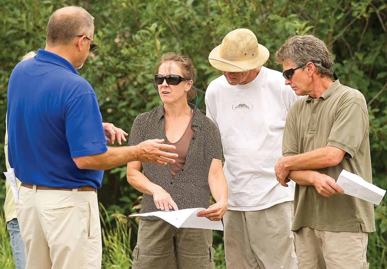 Sam Skramstad, director of facilities at Colorado Mountain College, talks with concerned residents, from left, Sarah Katherman, Robert Ellsworth and Kirk Kellogg about a proposed road that will provide secondary access to the Alpine Campus.