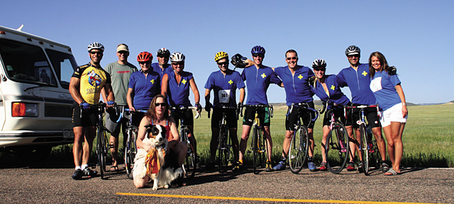 """""""Ride for Cody"""" participants in the 100-mile Tour de Prairie, June 23 near Cheyenne, Wyo., included, from left to right, Gary Gianetti, Chip Swanson, Liz Bristal, Paul Gilbertson, Michelle Baxter, Jeremy Hockley, Ryan Thompson, Dylan Dearborn, Wann McNiff, Kyle Lawton and Brittney Lewis as well as Paula Lepperoli (seated with dog, Callie)."""