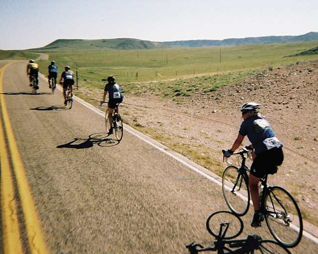 The main pack of local cyclists riding in memory of ski patroller Cody St. John, all completed the June 23, 100-mile Tour de Prairie in less than six hours.