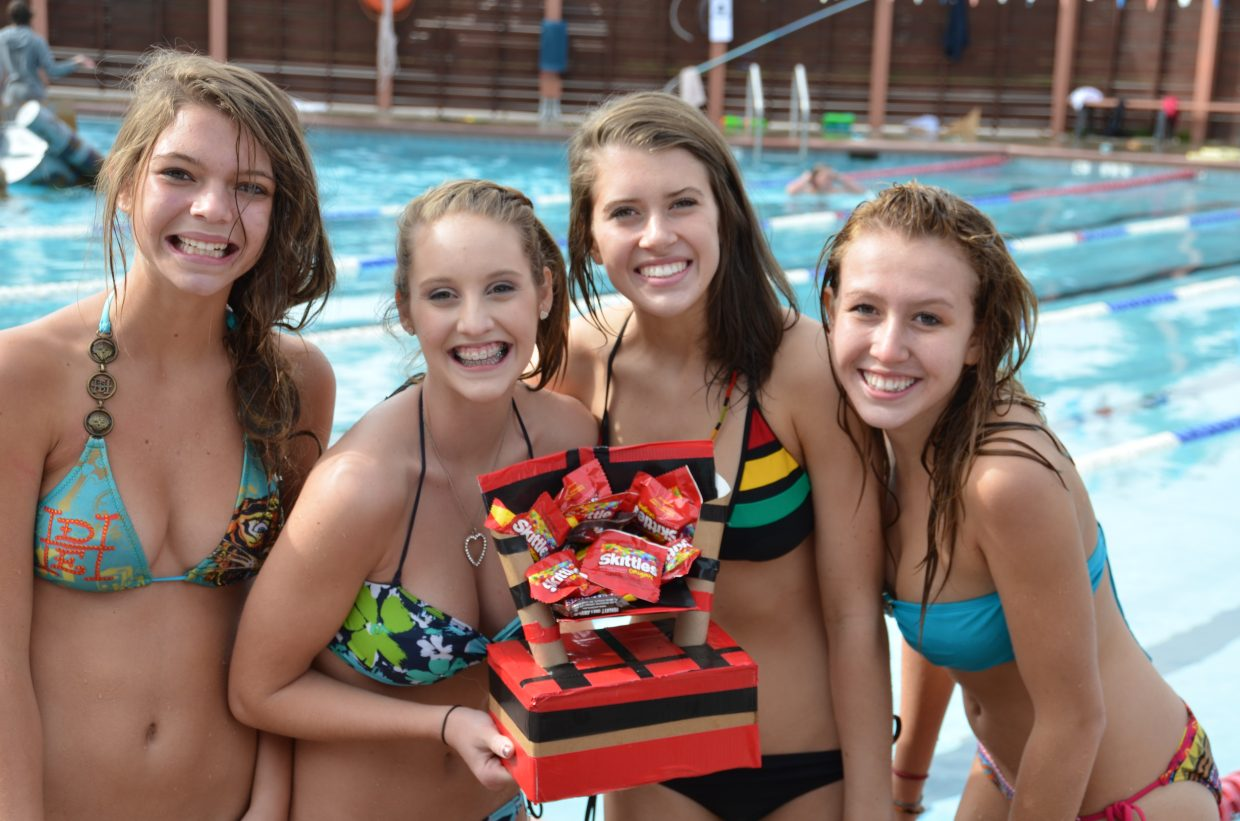 """Hannah Erickson, Brooke Bumgarner, Allison Williams and Calyx Ward finish third in the Cardboard Classic at Old Town Hot Springs on Friday in their boat """"Hippie Van."""" Submitted by: Shannon Lukens"""