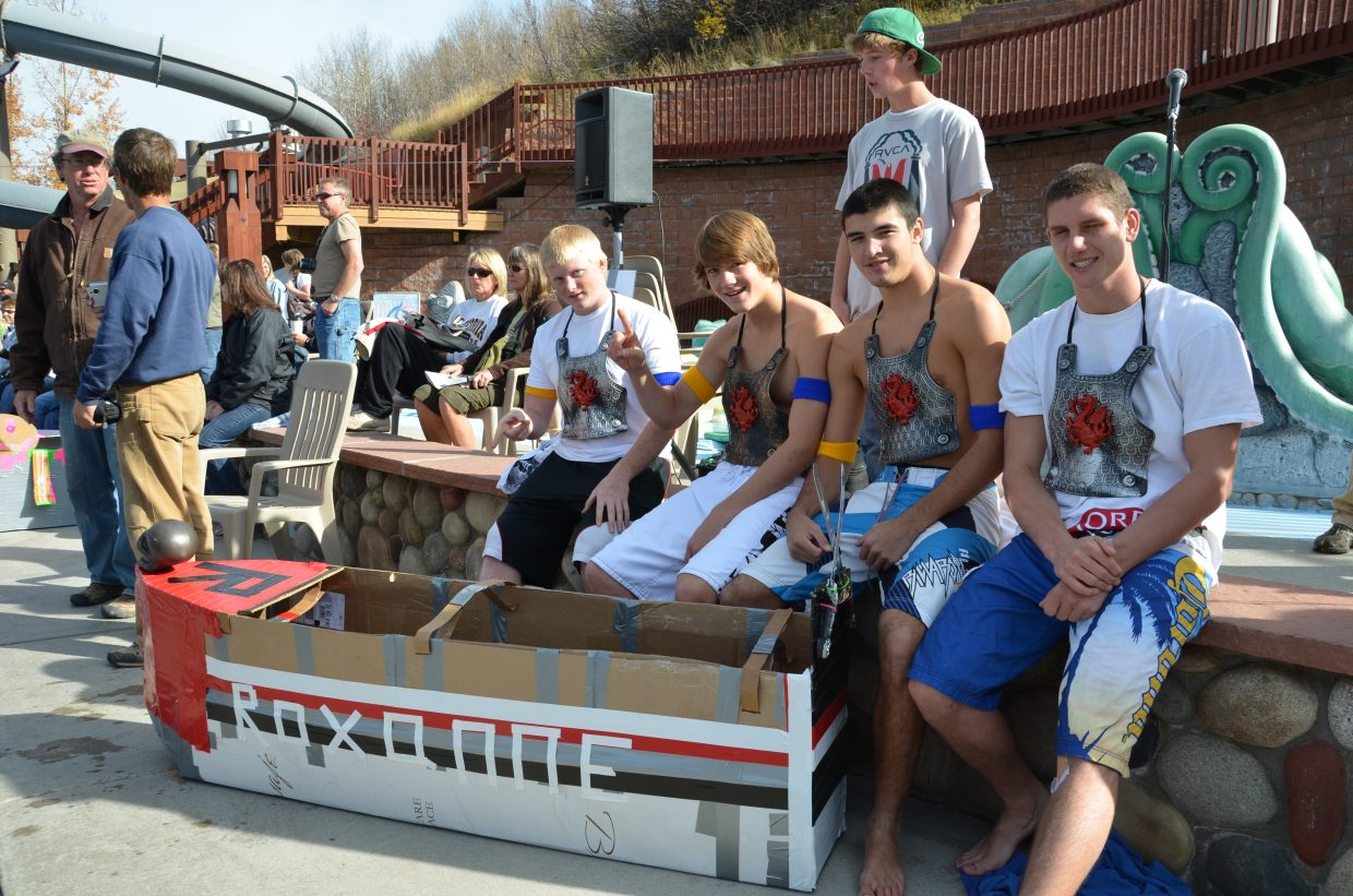 """Brad Ryan, Skylar Kauf, Mike Lekarczyk and Ben Custer sit with their boat """"Roxanne"""" at Cardboard Classic at Old Town Hot Springs on Friday. Submitted by: Shannon Lukens"""