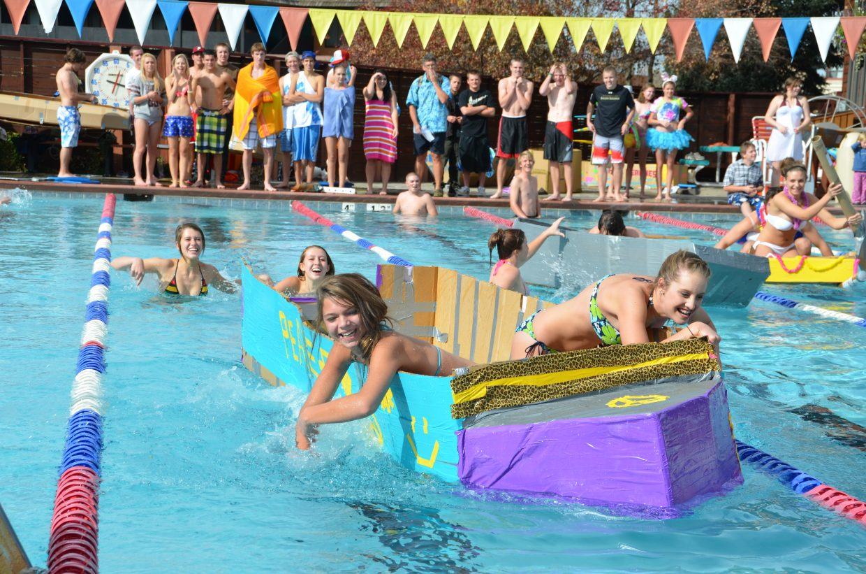 """Hannah Erickson and Brooke Bumgarner paddle hard in """"Hippie Van"""" to win their heat and eventually take third overall at Cardboard Classic at Old Town Hot Springs on Friday. Submitted by: Shannon Lukens"""