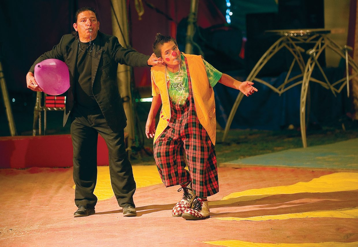 Janathan Pintado is pulled off the stage by Lalo Pintado in the first part of the American Crown Circus on Wednesday evening. The circus, which rolled into town Tuesday, will have performances at 5 and 7 p.m. today at the Brent Romick Rodeo Arena before heading to its next stop.