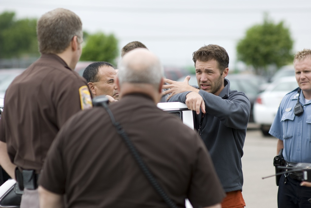 """April Showers"" writer and director Andrew Robinson talks to local law enforcement about a scene in his movie."