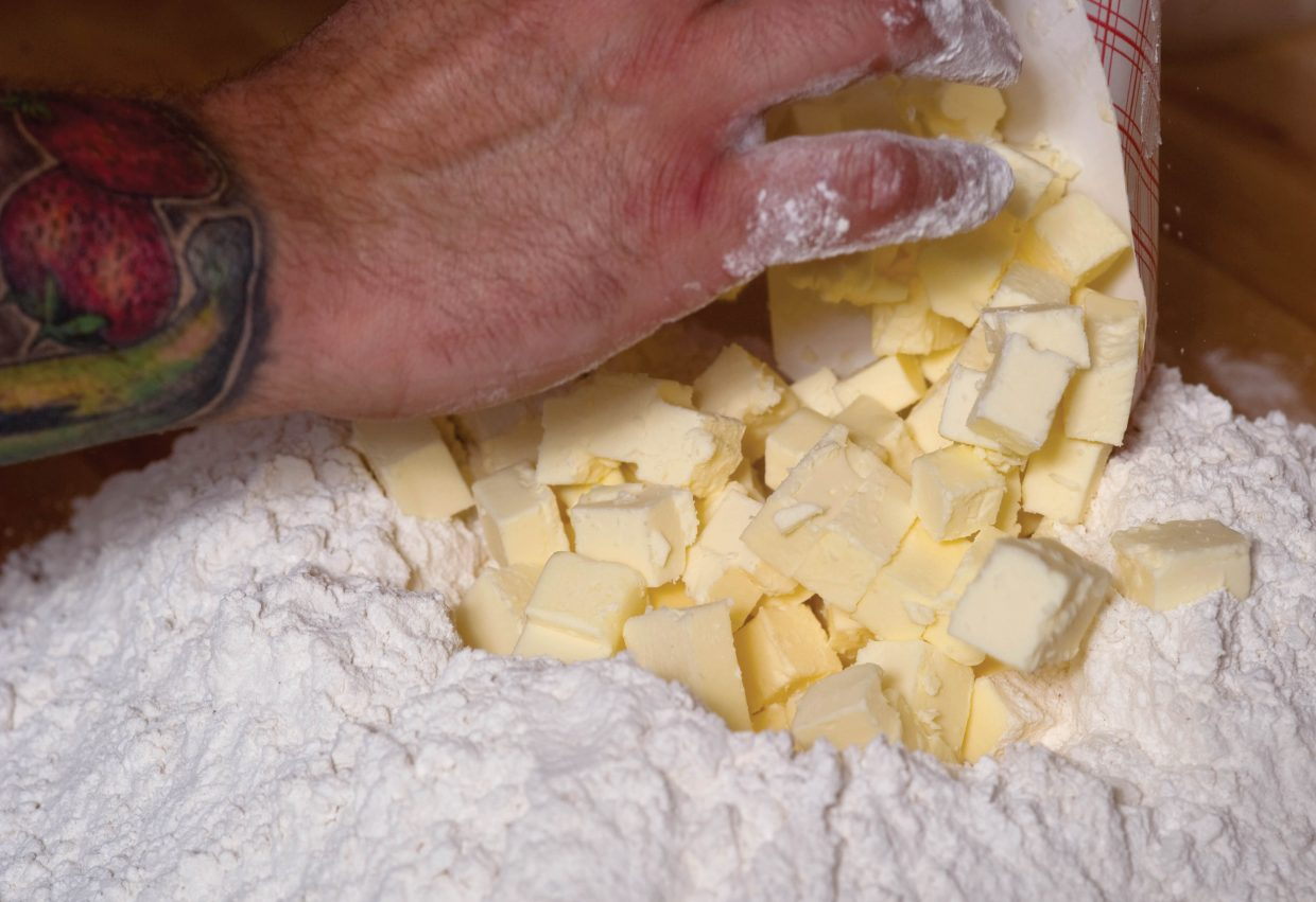 Chris McKenzie, general manager and executive chef, combines butter and flour while preparing biscuits for Lil' House.