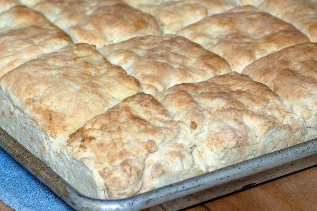 Finished biscuits come out of the oven.