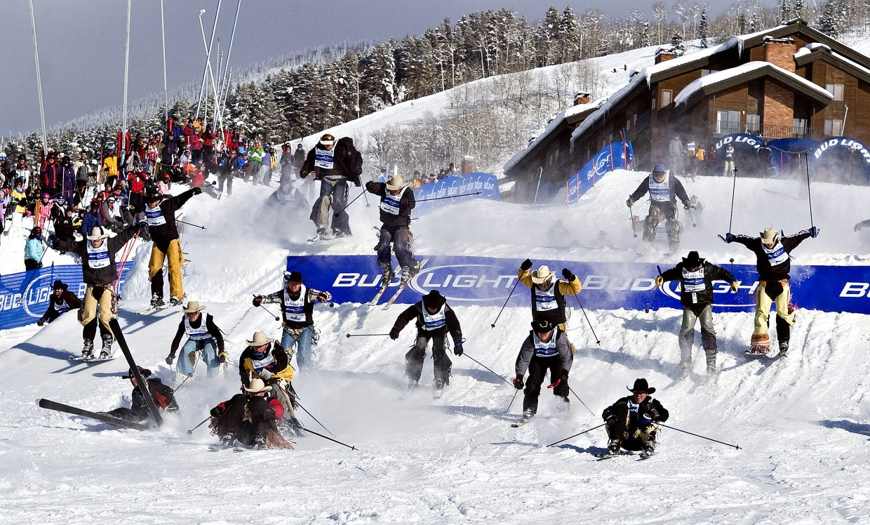 A herd of cowboys plow down Stampede trail during the 34th Annual Bud Light Cowboy Downhill at the Steamboat Ski Area on Tuesday afternoon.