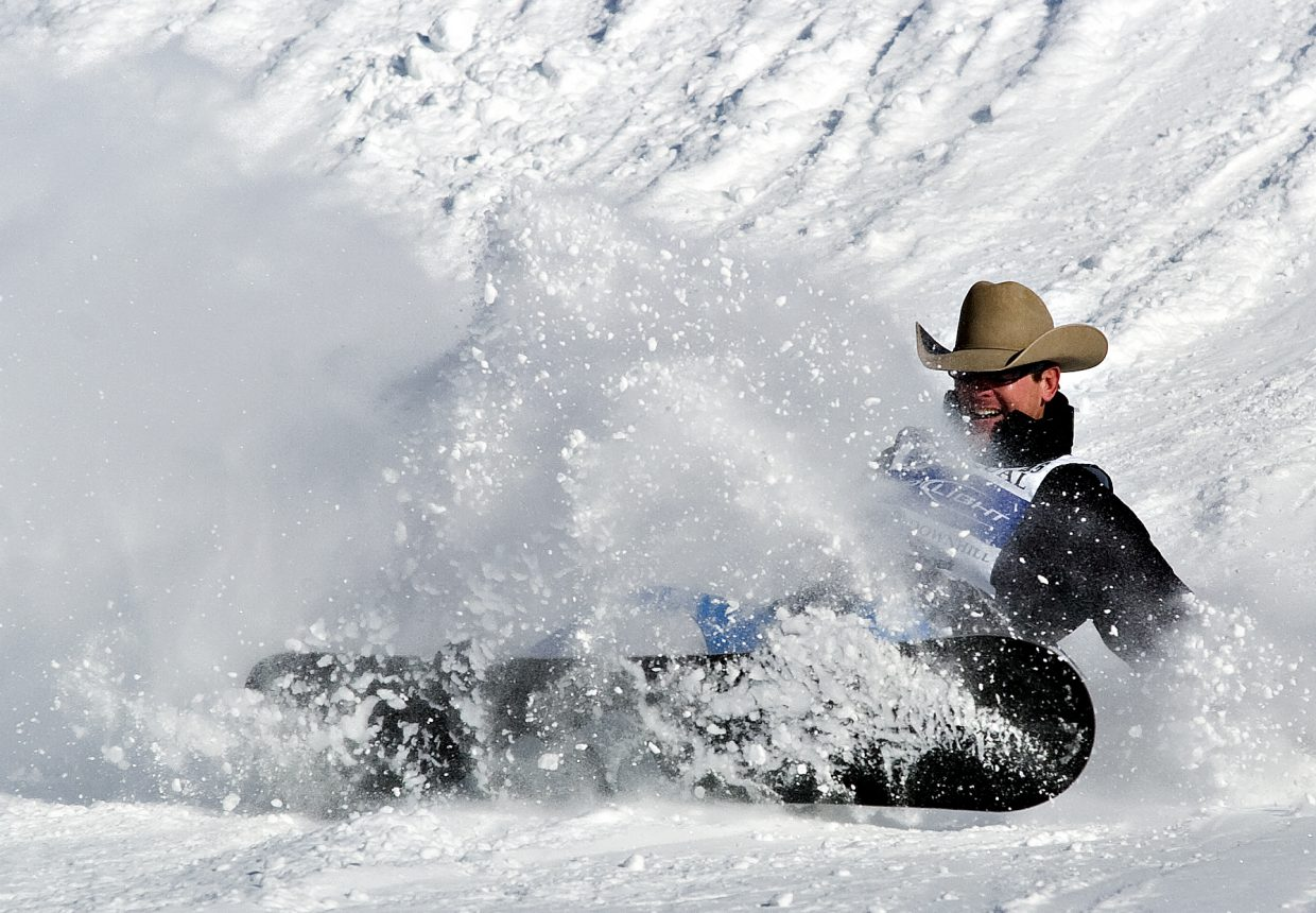 Competitor J.D. Thompson takes a fall after going over a jump on the Stampede trail at the Steamboat Ski Area on Tuesday afternoon during the 34th Annual Bud Light Cowboy Downhill.