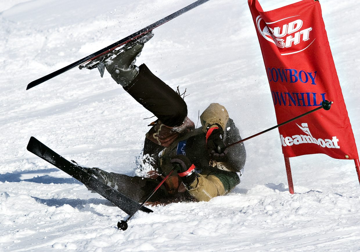 Competitor John Addison takes a fall after going over a jump on the Stampede trail at the Steamboat Ski Area on Tuesday afternoon during the 34th annual Bud Light Cowboy Downhill.