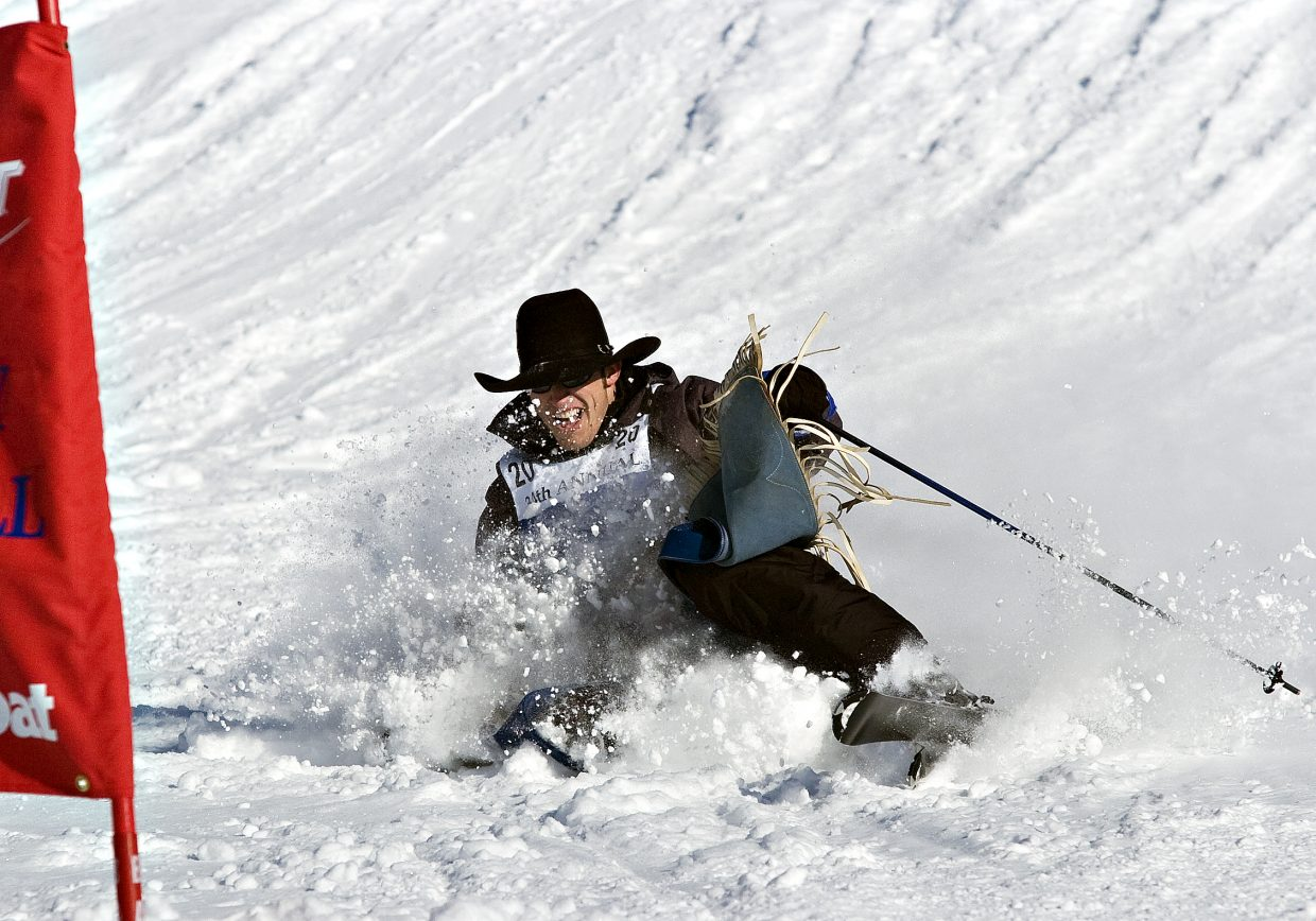Competitor Matt Bright takes a fall after going over a jump on the Stampede trail at the Steamboat Ski Area on Tuesday afternoon during the 34rd Annual Bud Light Cowboy Downhill.
