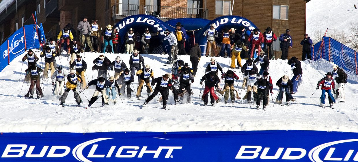 A huge group of cowboy competitors take off from the top of the Stampede trail at the Steamboat Ski Area on Tuesday afternoon during the 34rd Annual Bud Light Cowboy Downhill.