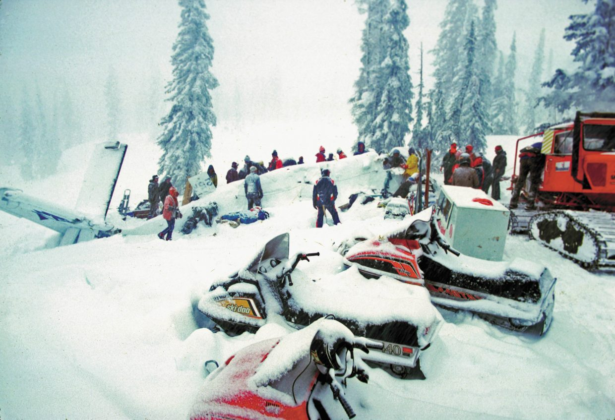 Rescuers came on snowmobiles and snowcats to assist Dec. 5, 1978, at the scene of the plane crash on Buffalo Pass.
