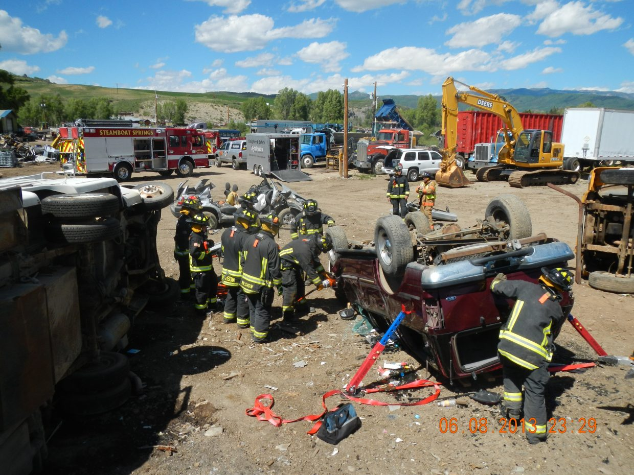 Steamboat Springs Fire Rescue fire vehicle extrication training at D & D Enterprises. Submitted by: Mel Stewart