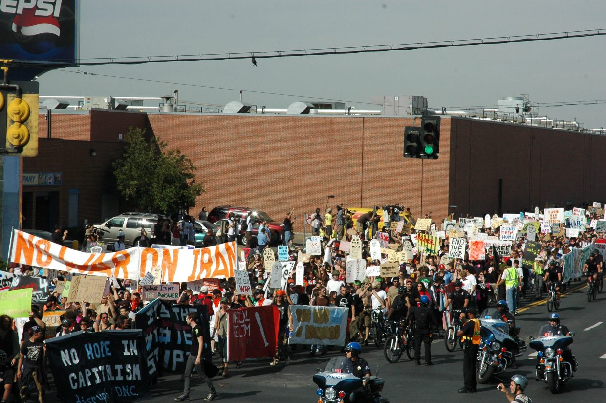 An anti-war protest march several blocks long makes its way from the Denver Coliseum to the Pepsi Center.