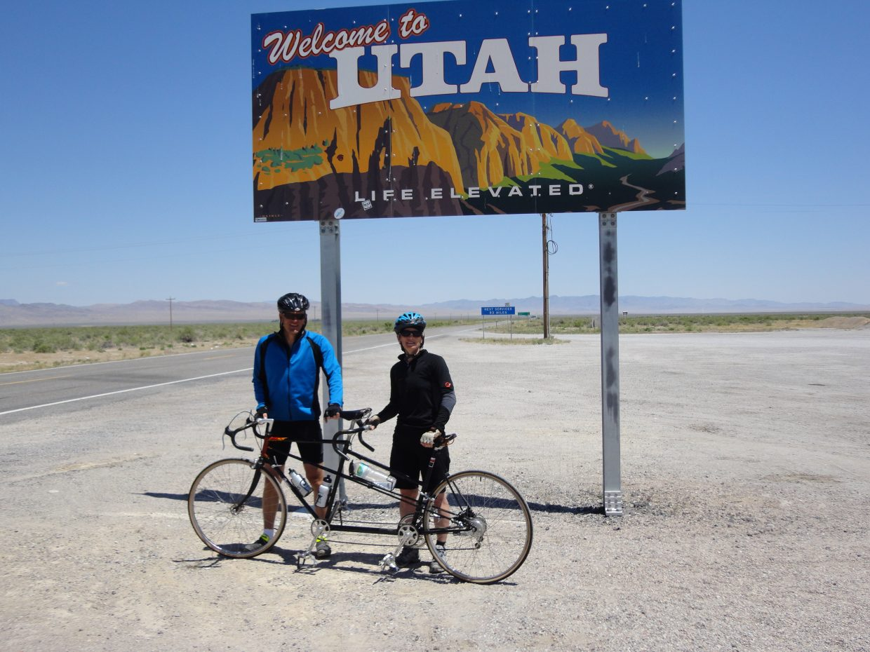 Steamboat residents Tim and Ashley Ficke just crossed the border after riding their tandem bike 400 miles along route 50, the loneliest road in America, from Reno Nevada to the Utah border. Submitted by: Judy Duncan