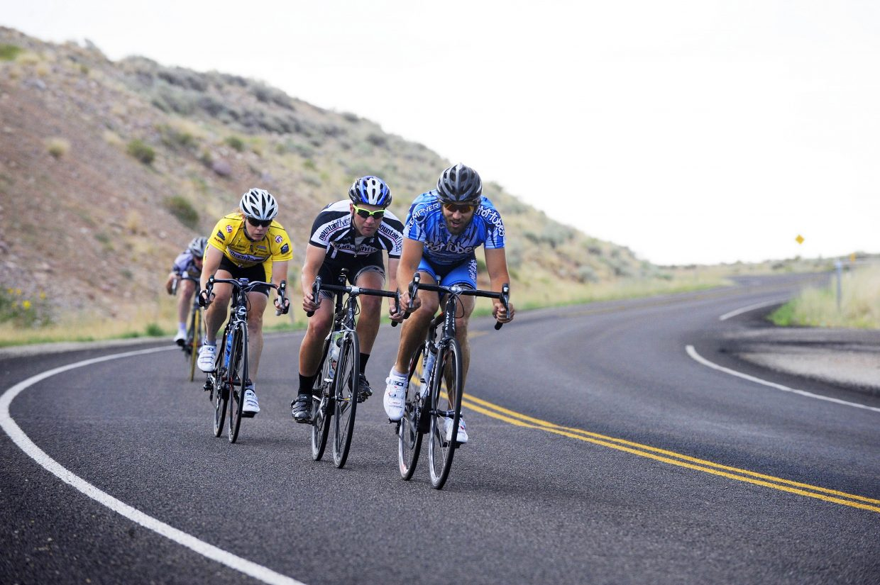 SmartWool ride participants, from right, Tim Reinhart, Jordan Carr and Leslie Mittendorf cruise down a hill outside Vernal, Utah.