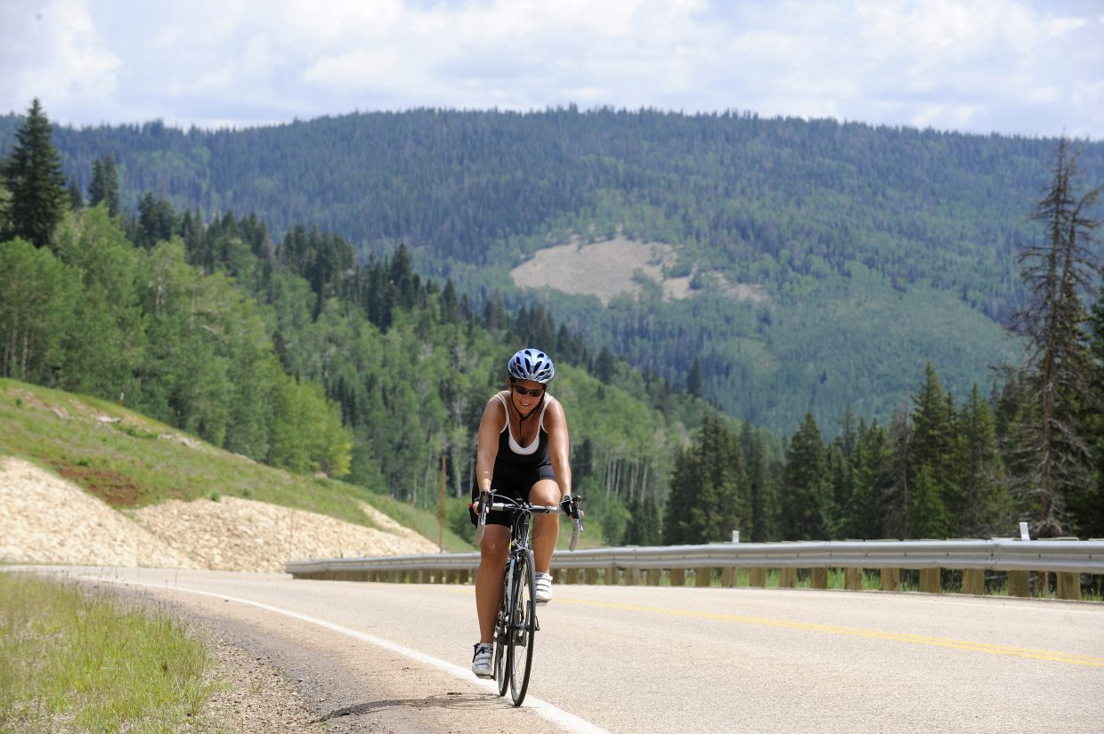Ride organizer Amy Beck pedals up Wolf Creek Pass during the final day of riding.