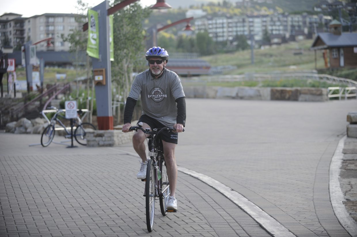 Rick Peterson leaves the base of Steamboat Ski Area early Sunday for a 55-mile ride as part of the Biking the Boat Charity Ride. This year's event included 5-, 26-, 55- and 100-mile rides.