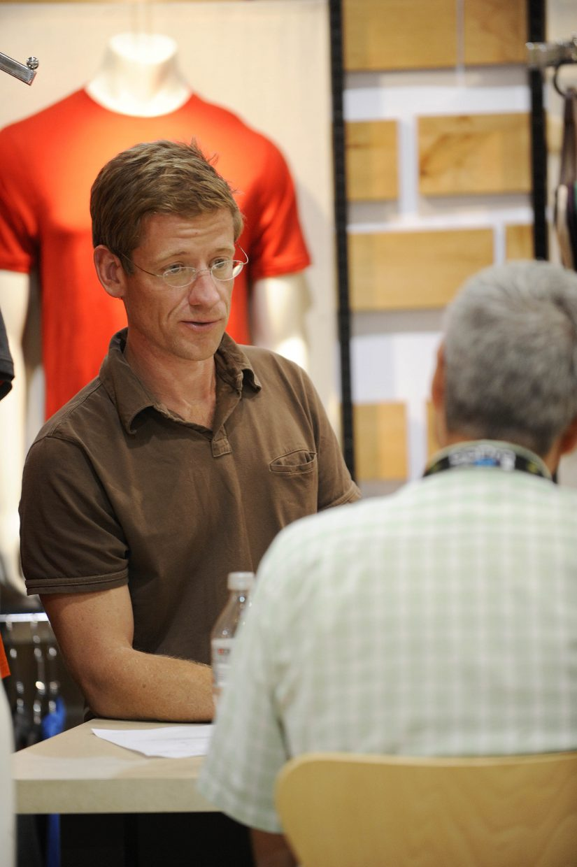 SmartWool sales representative and ride participant Rion Smith meets with a customer at Outdoor Retailer.