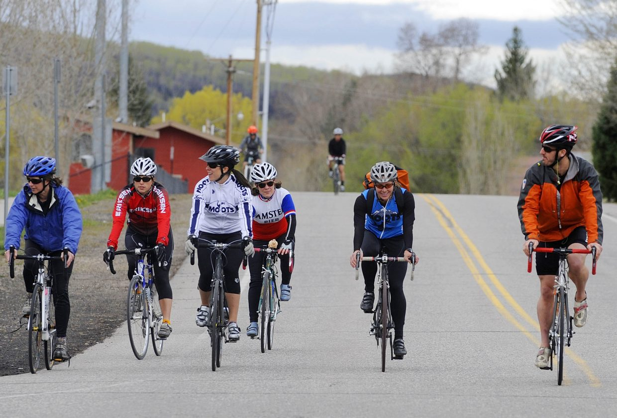 Triathlon club members, from left, Gail Garey, Julie McFadden, Adrienne Stroock, Shelia Wright, coach Amy Charity and Danny Weiland ride to Spring Creek for a time trial.