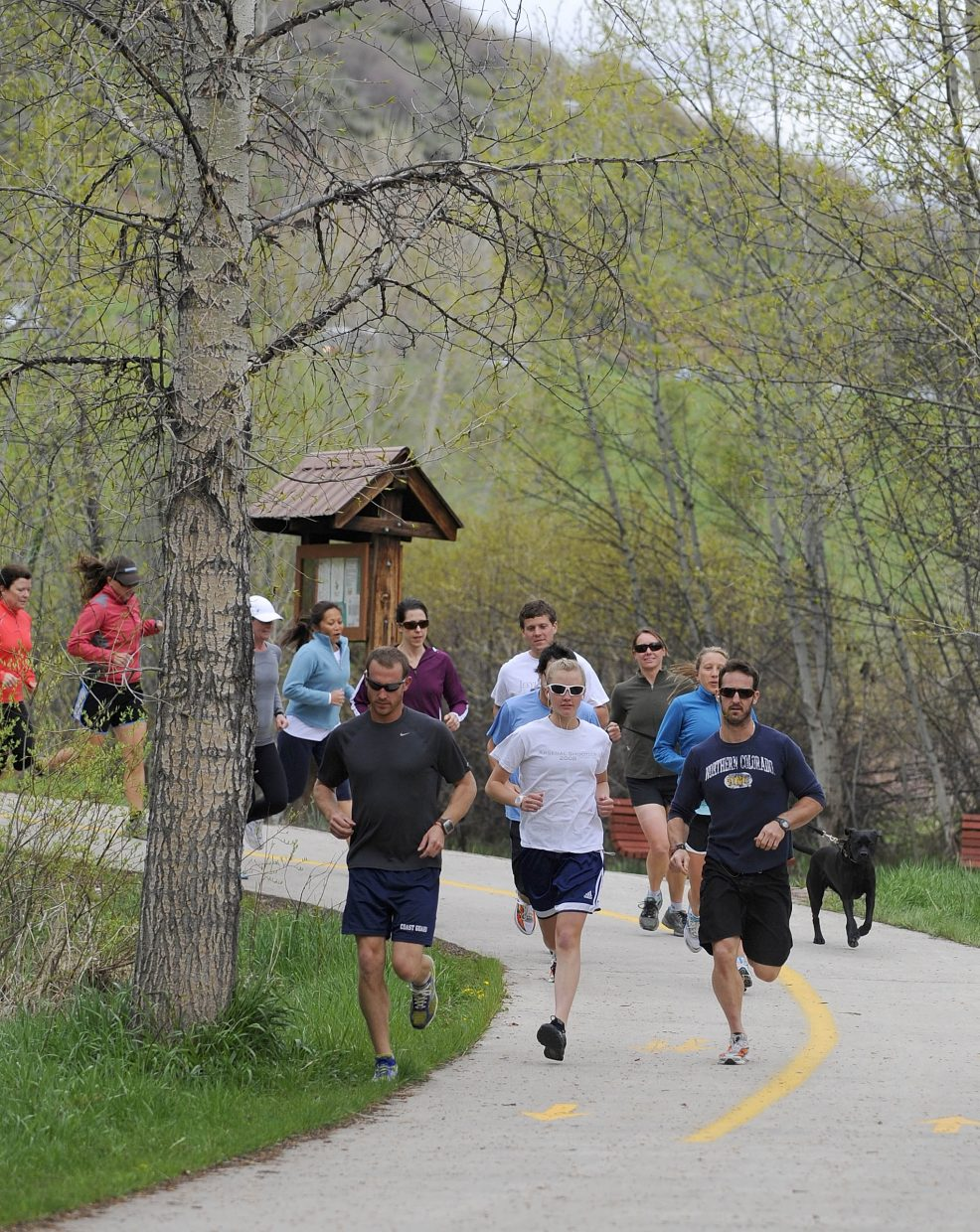 Members of the Old Town Hot Springs triathlon club practice their running.