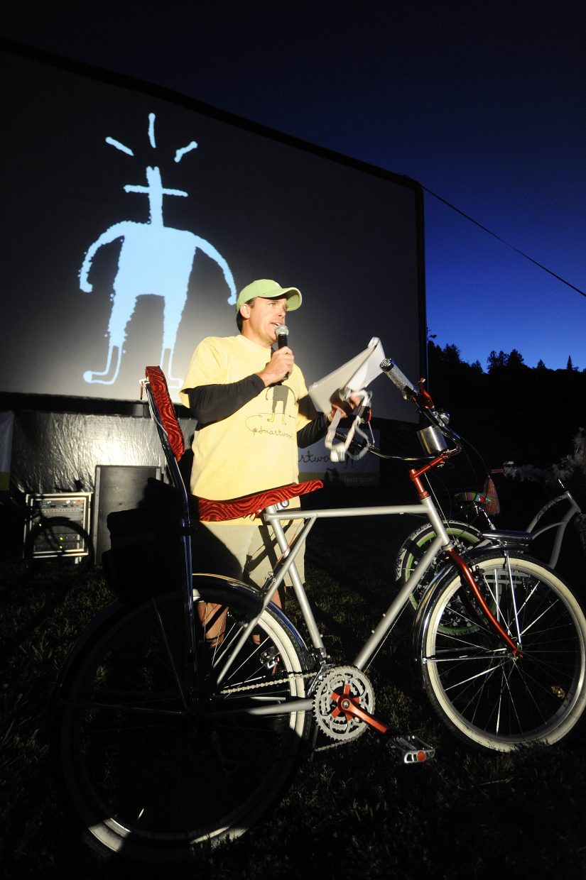 SmartWool Field Marketing Manager Gardner Flanigan asks for the audience's help in choosing the best cruiser bike during SmartWool's second annual Bike-in Movie on Aug. 15 at Howelsen Hill.