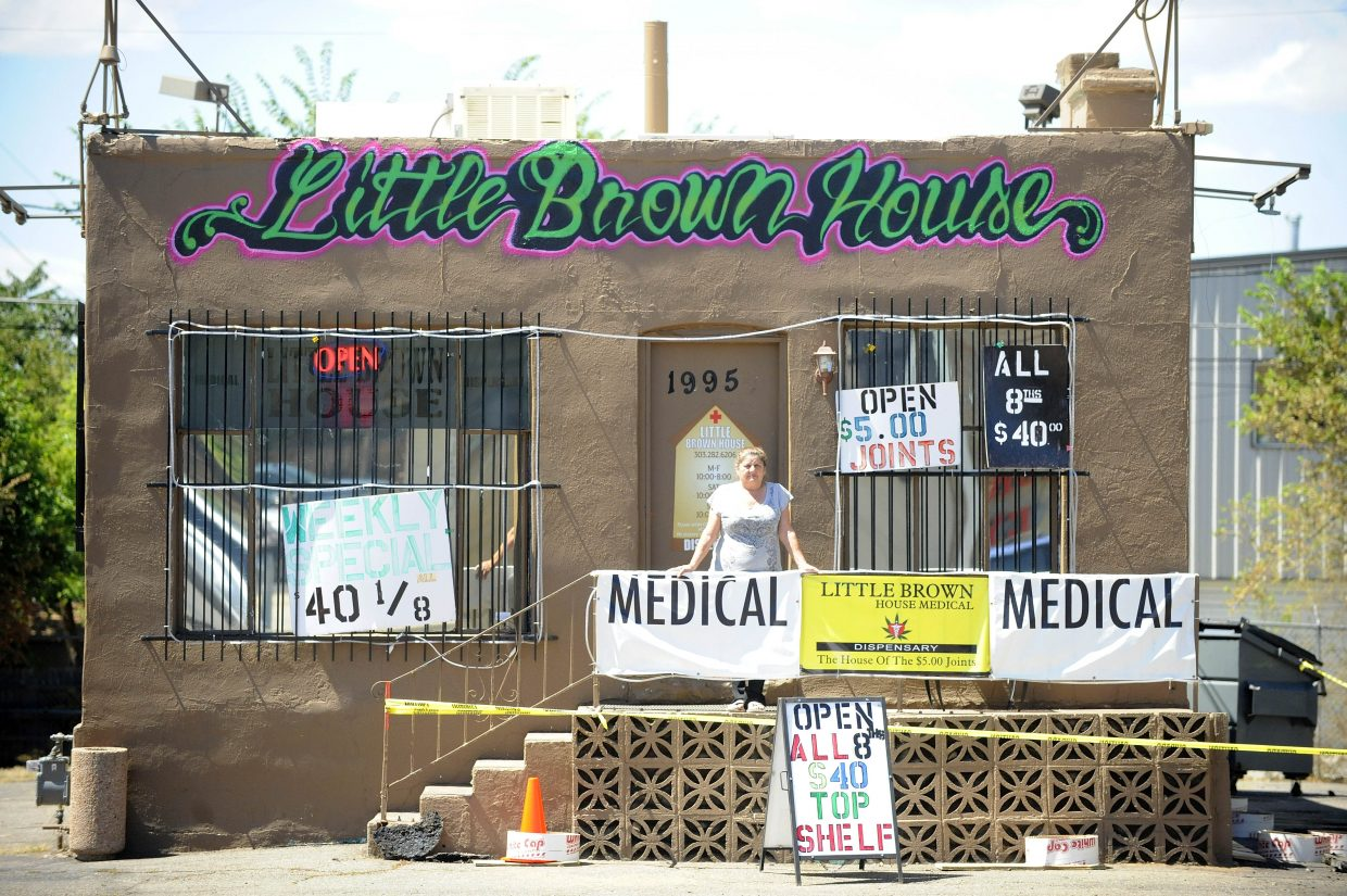 Flo Barron, who owns Little Brown House on South Broadway Street in Denver, doesn't mind being near three other medical marijuana centers.