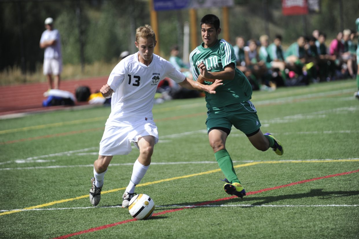 Steamboat Springs senior Carter Kounovsky, left, battles for a ball in Saturday's game against Delta. Steamboat went on to win, 4-2.