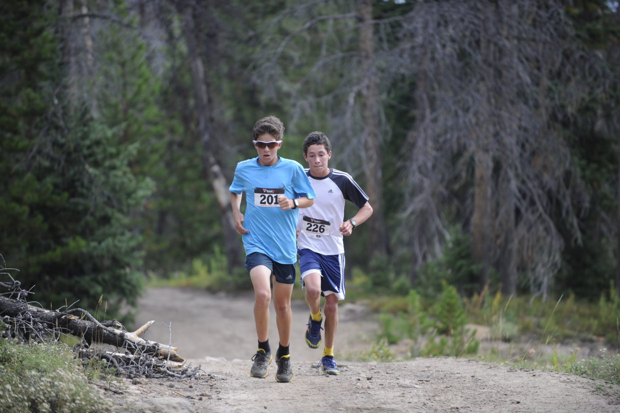 Evan Barbier, front, and Tyler Terranova approach the last bit of the 5-kilometer race during the 10K at 10,000 Feet Steamboat Springs Running Series event Sunday. Barbier was second followed by Terranova.