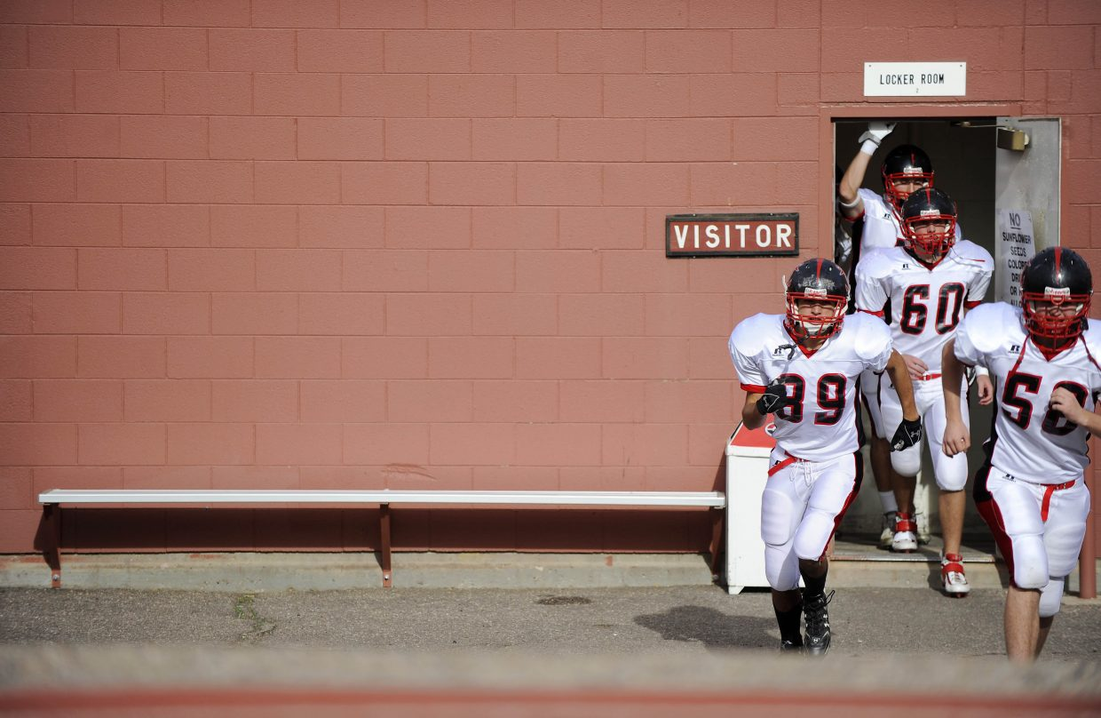 The Steamboat Springs High School football team takes the field for Saturday's game against Pueblo Central.