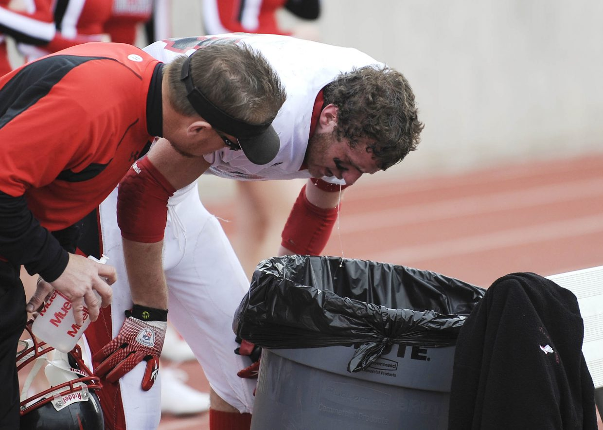 Senior Joe Dover throws up after an exhausting sprint into the end zone during the first half.
