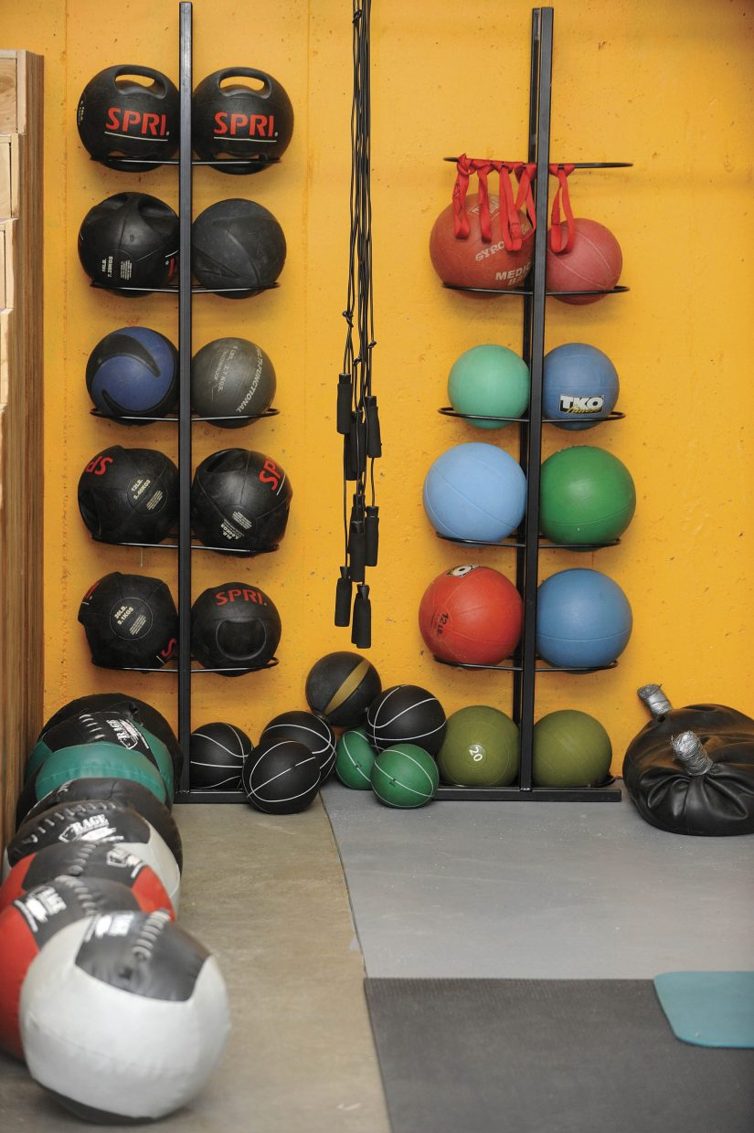 A variety of medicine balls line the wall at Manic Training.