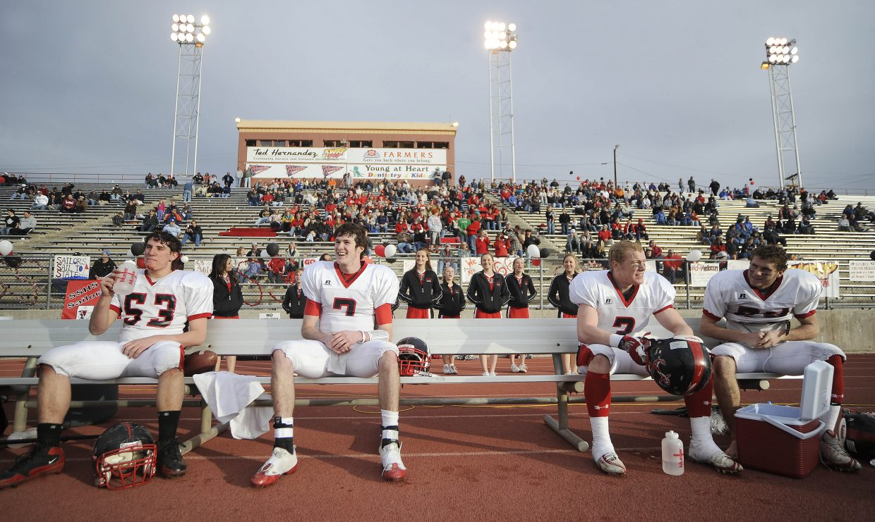 Steamboat Springs High School football players, from left, Darien Buelter, Austin Hinder, Connor Landusky and Joe Dover wait out the final minutes of Saturday's game against Pueblo Central.