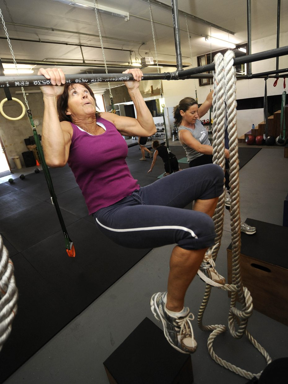 Pam Good does a pull-up at Manic Training.