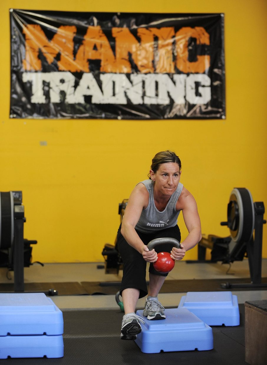 Alexis Rauso does a single-leg squat during a workout at Manic Training.