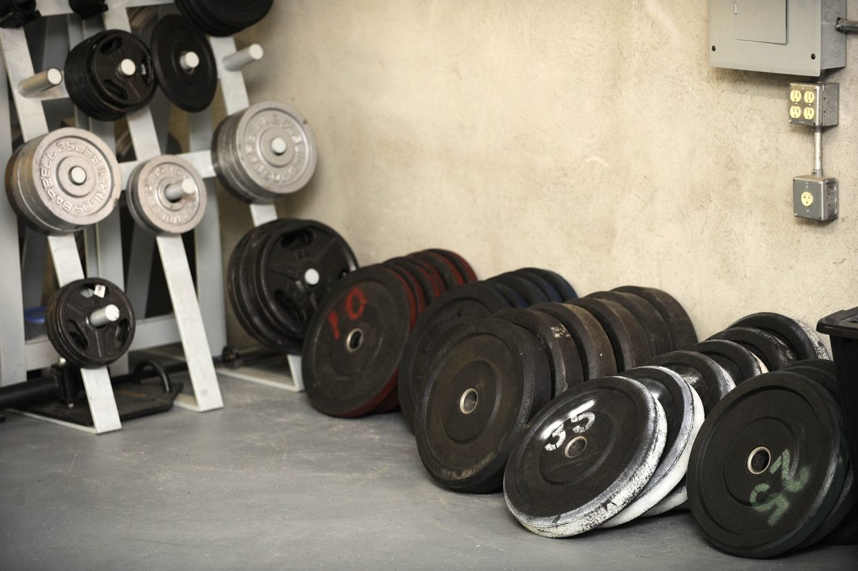 A variety of weights sit against a wall at Manic Training.