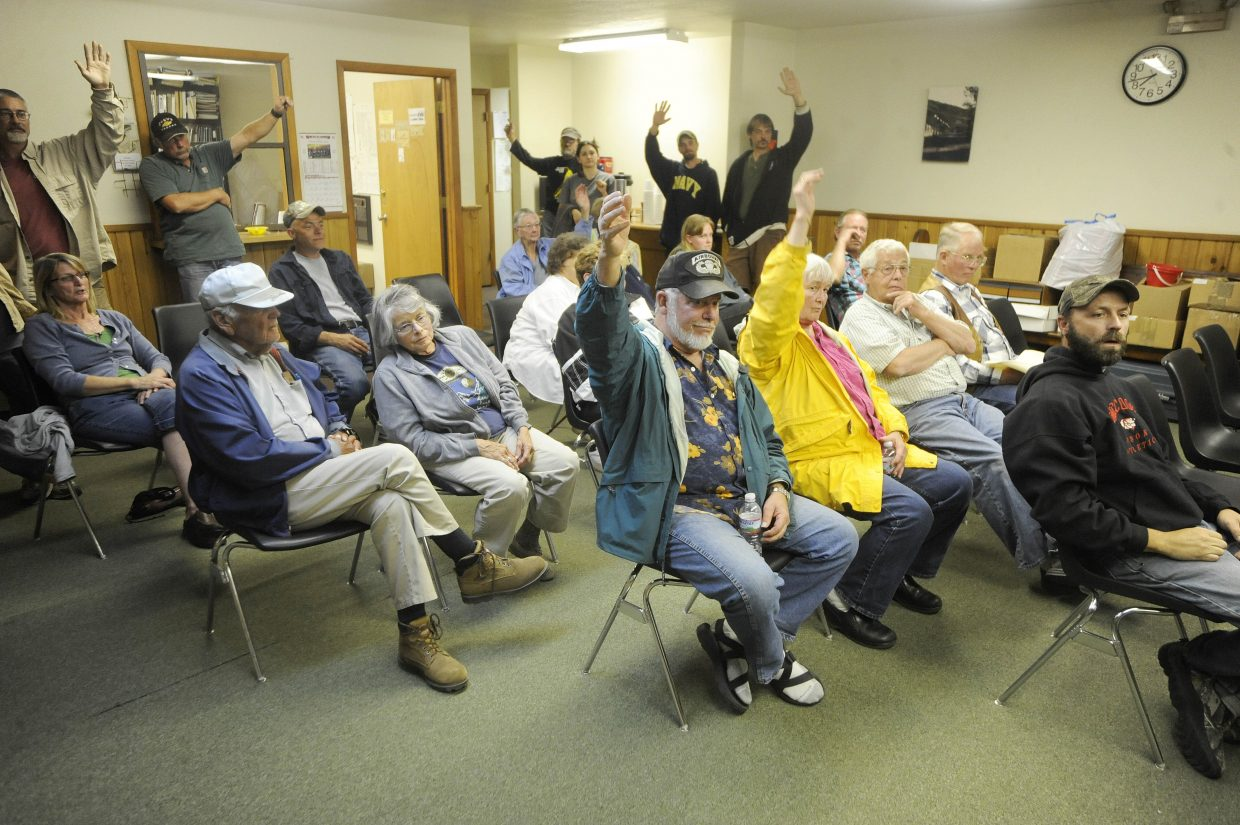 Yampa residents raise their hands in support of medical marijuana.