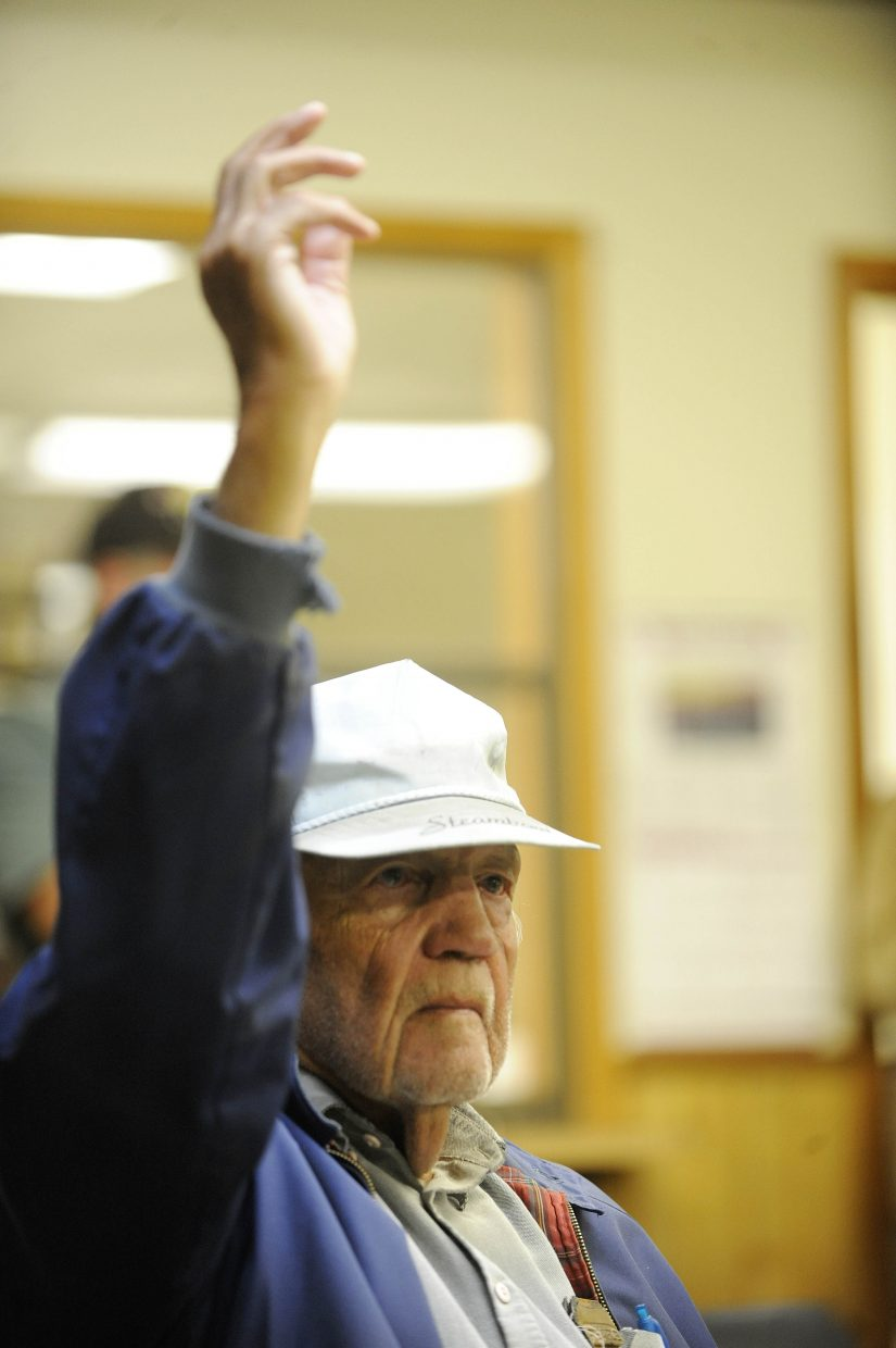 Yampa resident William Lee raises his hand showing he is against medical marijuana.